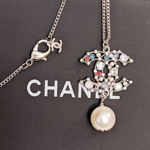 Jewelry - Multi color crystal pendent necklace silver tone
